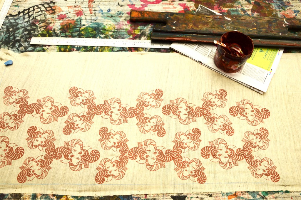 Screen printing the patterns on silk fabric